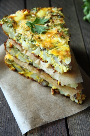 Spanish tortilla with slices of fresh greens, food