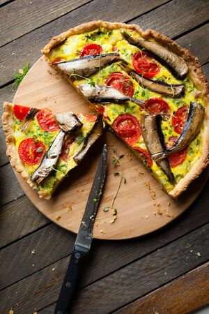 sprats: Vegetable quiche with sprats Stock Photo