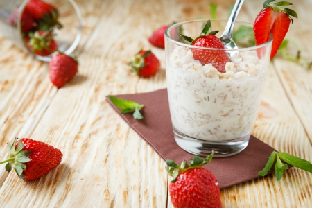 musli: corn flakes with milk and strawberries, food close up