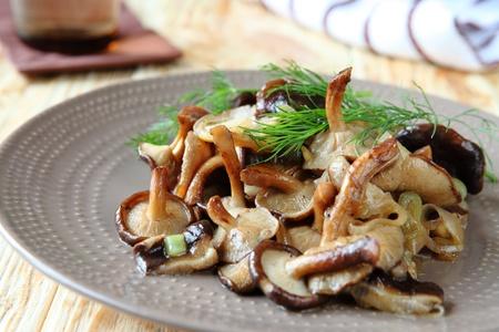 shiitake: fried shiitake mushrooms on a plate, close up Stock Photo
