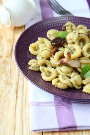 Italian pasta with mushrooms, food close up photo