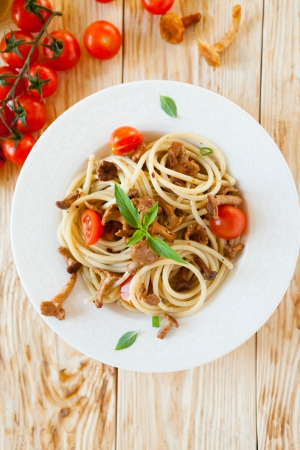 spaghetti with pesto and cherry tomatoes, top view photo