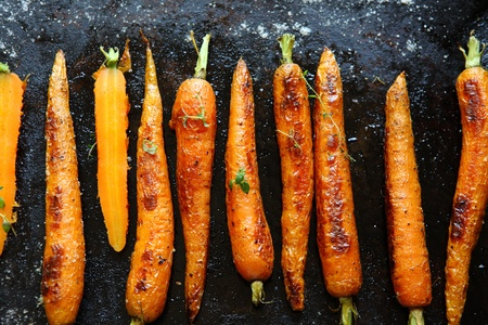 baked carrots on a baking sheet, food close up Stock Photo