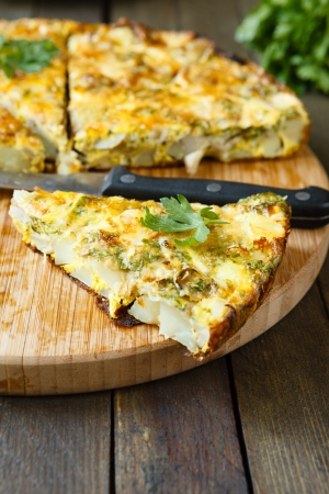 Frittata slices on a cutting board and knife, food close up
