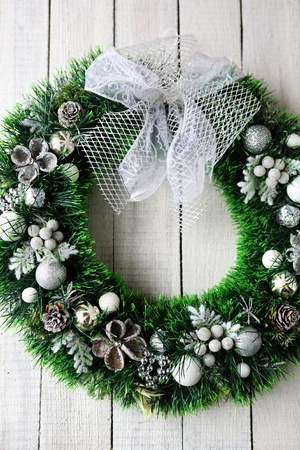 green Christmas wreath on the white door, holiday photo