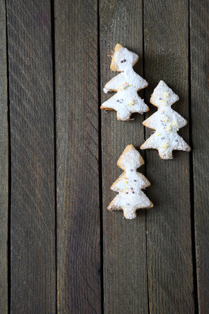 cookies in the shape of a Christmas tree on the boards, food close up photo
