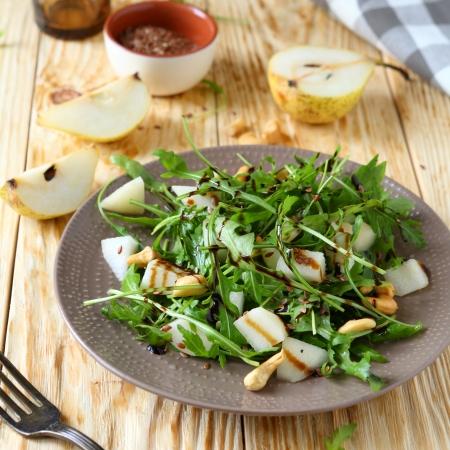 salad dressing: fresh salad with pear and arugula, food Stock Photo