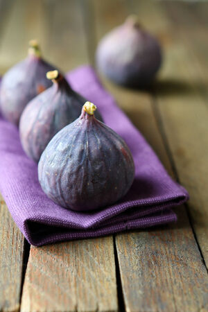 Ripe figs on the table, fruits closeup