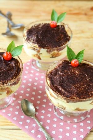 three tiramisu dessert on wooden table, food Stock Photo - 23239078