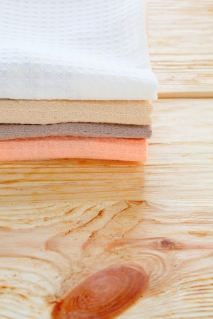 toweling: stack of cotton kitchen towel on wooden table, textile