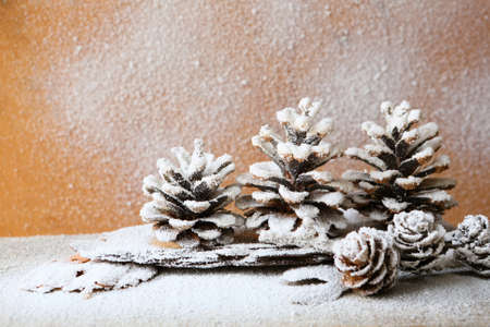 christmas background with pine cones, decorations with snow photo
