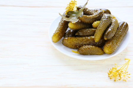 pickled cucumbers on a white plate, food Stock Photo