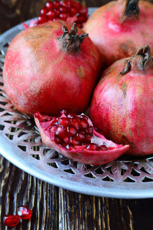fresh juicy red pomegranate, fruits photo