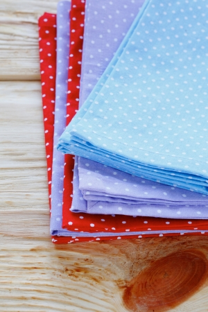 stack of towels with polka dots, textile photo
