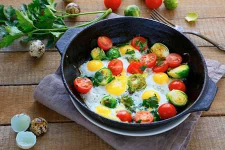 fried eggs with vegetable mix, rustic food