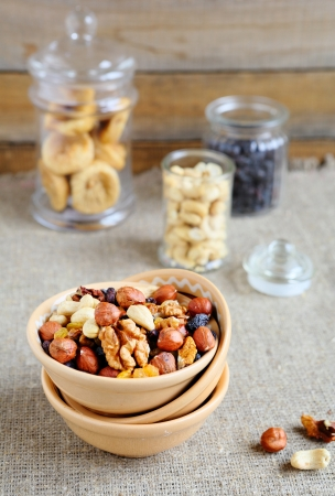 nuts in a bowl and jars, food closeup