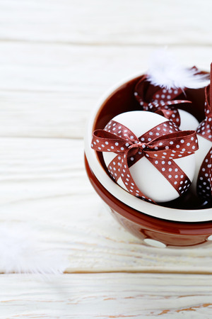 chocolate easter eggs in a bowl, food closeup Stock Photo