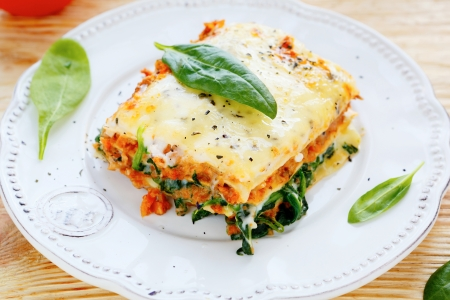 Lasagna with meat and spinach, food closeup