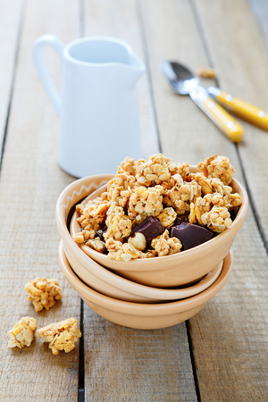 granola with chocolate and nuts for breakfast, food closeup photo