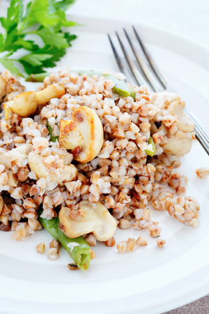 kasha: crumbly buckwheat with mushrooms, food closeup