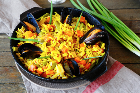 Spanish paella with mussels, food closeup Banco de Imagens
