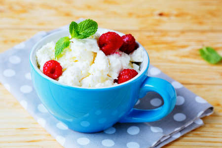 cottage cheese with fresh raspberries, food closeup photo