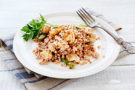 kasha: Buckwheat porridge with mushrooms fried, food Stock Photo