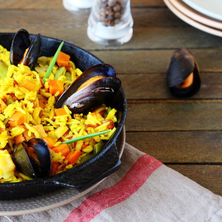 rice paella with mussels, food closeup photo
