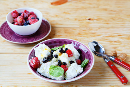 breakfast cottage cheese and berries, food closeup Stock Photo