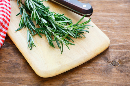 fresh rosemary on a kitchen board photo