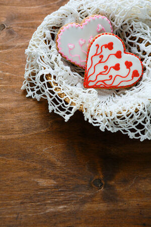 heart shaped cookies with frosting, food closeup photo