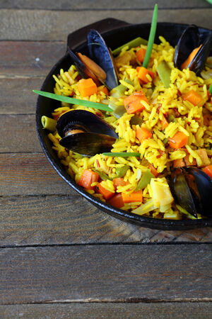 basmati rice with vegetables and mussels, food closeup photo
