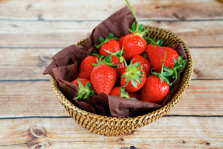 ripe strawberries in a basket, food closeup photo