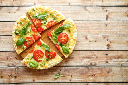 mouthwatering: mouthwatering pizza with tomatoes, top view, food