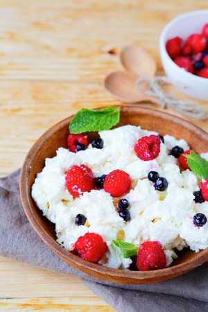 cottage cheese with raspberries and blueberries, food closeup photo