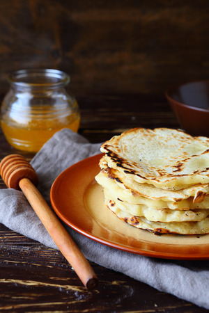 plate of food: simple rustic pancakes on plate, food closeup