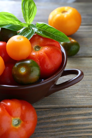 colorful tomatoes in a bowl, food closeup photo