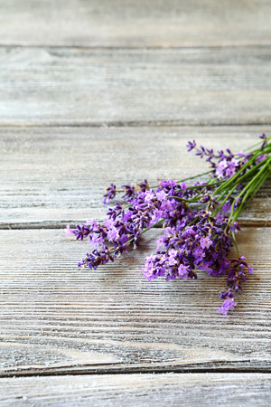 Bunch of fresh  lavender flowers on old wooden table