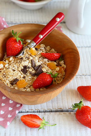 granola with ripe strawberries in a bowl food photo