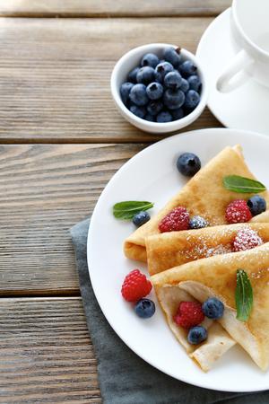 pancake week: crepes with blueberries and raspberries food closeup Stock Photo