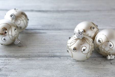 silver balls: Beautiful balls on wooden boards, closeup. Christmas Stock Photo