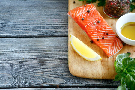 lemon: Red fresh fish, salmon on board, food close up Stock Photo