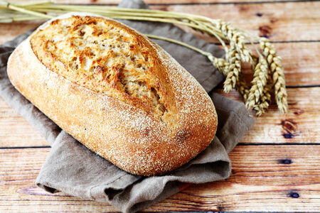 fresh loaf of bread on a linen napkin, food photo