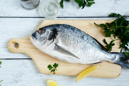 sea bream: Fresh sea bream and paper, seafood