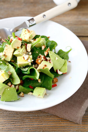 spinach salad: Salad with avocado and spinach, close up