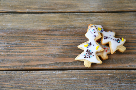 holiday food: Three cookies in the shape of Christmas trees, sweet holiday food