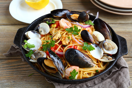 pasta: Pasta with seafood in a pan, nutritious food