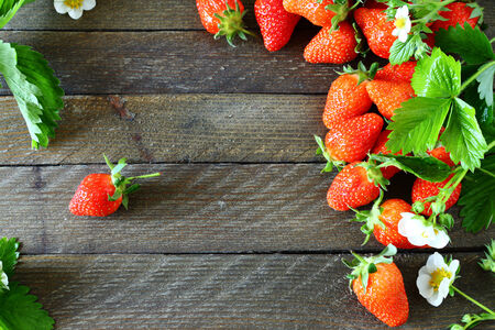 Delicious strawberries on wooden boards, top view Banco de Imagens