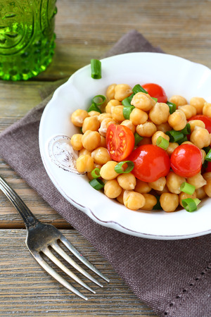 garbanzo bean: Salad with chickpeas and tomatoes on a bowl, food close up