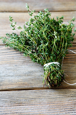 fresh leaf: Bunch thyme on wooden boards, close up